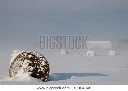 Winter Landscape With Fog And Bale