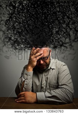 Man and chaos in mind. Frustrated man.