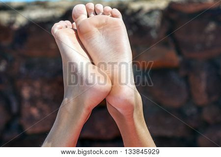 feet of relaxed young boy in the air