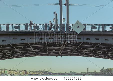 Drawbridge over Neva river in St.Petersburg, Russia. Closeup view from sailing boat. stylized with split-tonning
