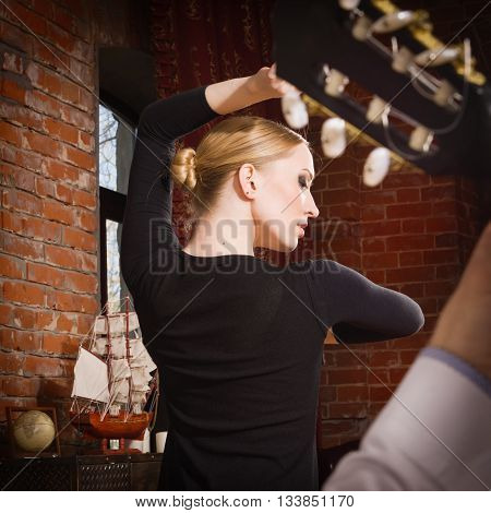 Young woman dancing flamenco in traditional flamenco dress