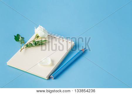 White Rose Flower Are On The Notebook