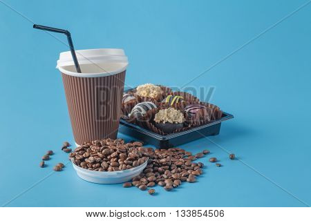Cup of coffee and coffee bean on blue background