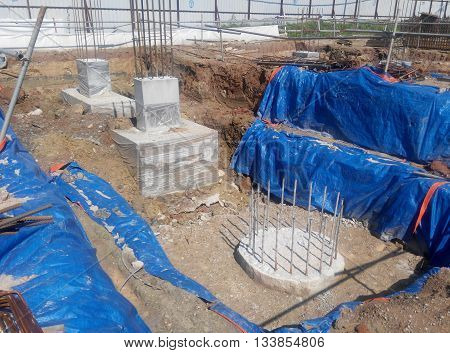 JOHOR, MALAYSIA -MARCH 28, 2015: Excavated bore pile and ready to cut to designated level at the construction site. The bore pile must cut before can fabricate the pile cap.