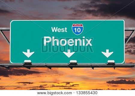 Phoenix Interstate 10 west highway sign with sunrise sky.