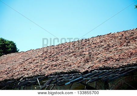 old roof of a barn broken and fallenbrick
