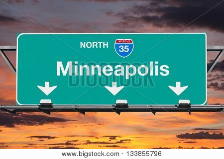 Minneapolis Interstate 35 north highway sign with sunrise sky.