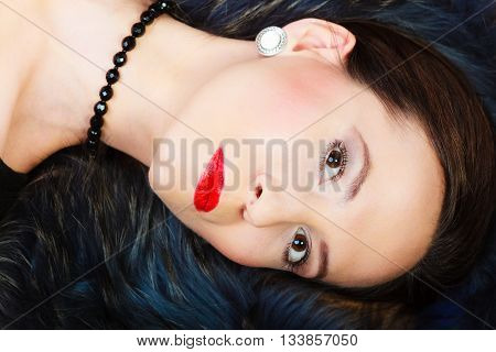 Fashion elegance and beauty. Woman in fur coat beautiful face makeup red lips lady retro style portrait