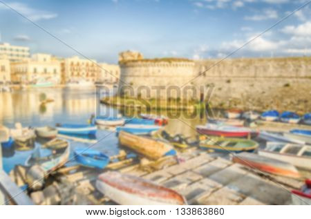 Defocused Background Of Angevine-aragonese Castle In Gallipoli, Italy