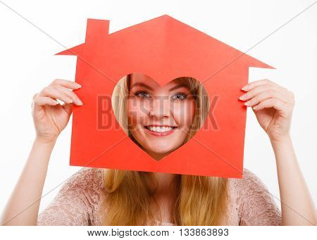 Romance feelings family future relationship marriage concept. Gorgeous girl looking through love. Blonde young woman peeking by heart cutout in home model.