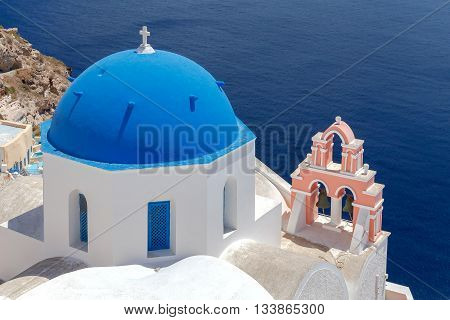 Traditional small white church in Oia on Santorini. Greece.