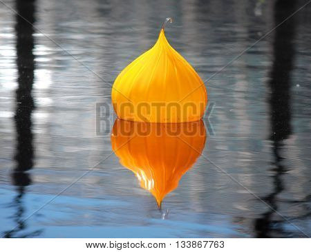 Orange color decorative float in the water