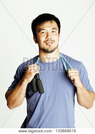 young asian guy with skipping rope on white background ready to training sport, lifestyle people concept in studio