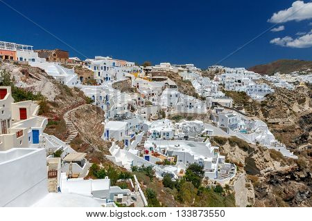 Traditional narrow street down to the sea in the village Oia. Santorini Greece.