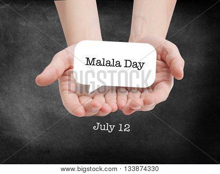 Malala Day written on a speechbubble