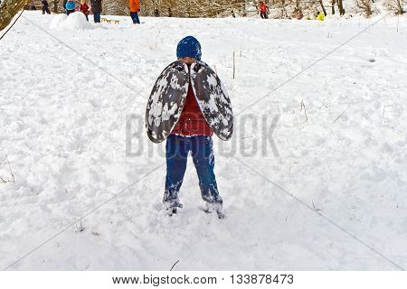 Children Have A Snowball Fight In The White Snowy Area