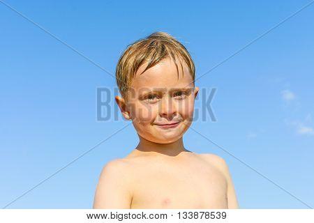 Portrait Of Cute Boy At The Beach