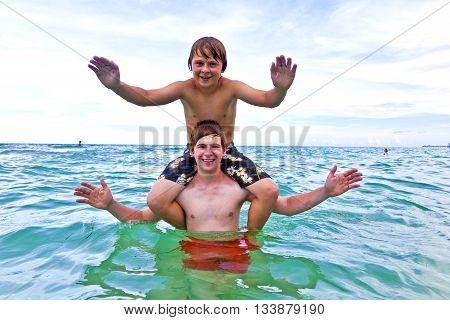 Boys Have Fun In The Beautiful Clear Sea