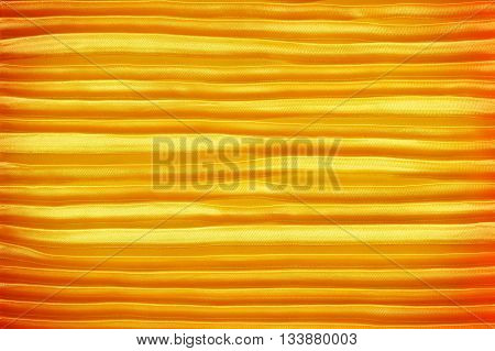 Dark gold creased fabric silk for background