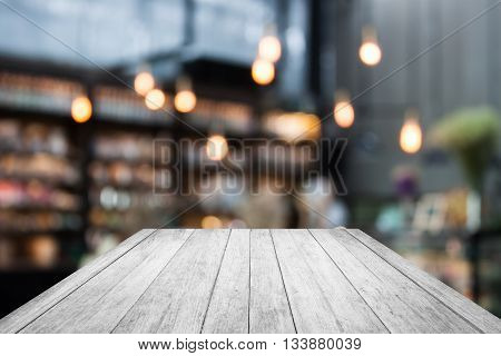 Black and white wooden on coffee shop blurred background with bokeh, stock photo