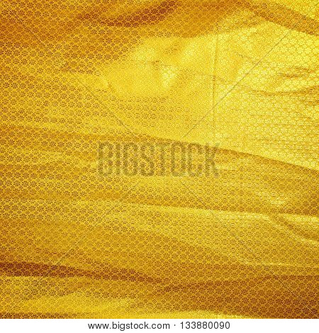 Creases fabric embroidered with sparkling gold sparkling