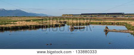 Anchorage Alaska USA - May 28 2016: Alaska Railroad travels along Turnagain Arm past Potter Marsh taking cruise ship passengers to Seward