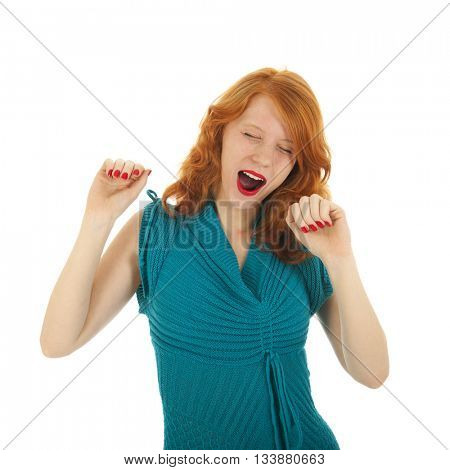 Portrait yawning attractive woman with red hair isolated over white background