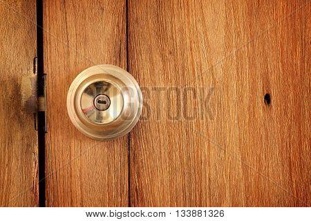 metal handle on a old wooden door