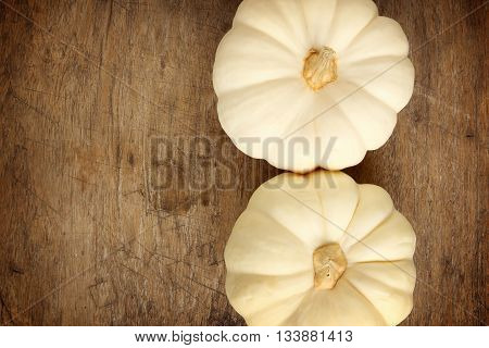 White background pumpkin on a wooden floor.
