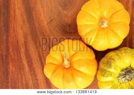 Background yellow pumpkin on a wooden floor.