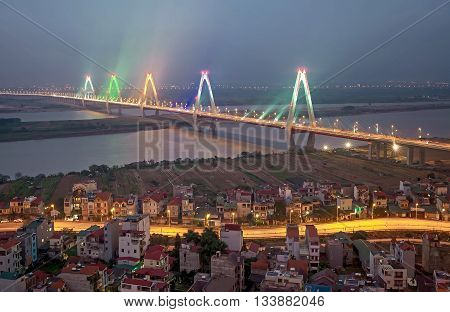 HA NOI, VIET NAM, December 12, 2016 cable-stayed bridge, Nhat Tan, Hong River crossing, Ha Noi, Vietnam. Because Japanese architectural construction. Shimmering electric light, at night