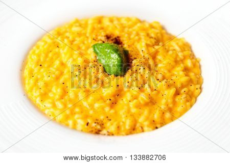 Risotto with saffron and vegetable ice-cream, close-up