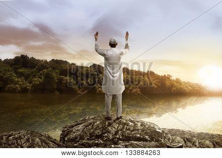 Young Muslim Man Praying On The Lake