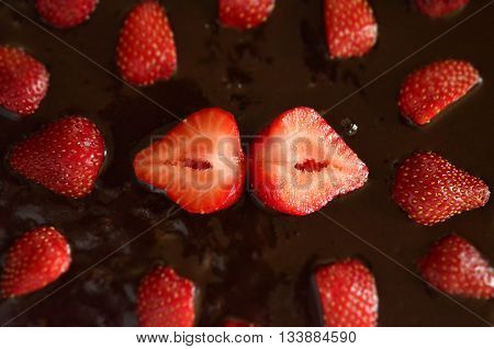 Desert Strawberries and Chocolate Carrot Cake with focus in the center. Red, Brown, Food, Vitamin C Strawberries, Cake from Above.