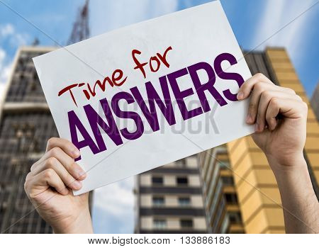 Time for Answers placard with cityscape background