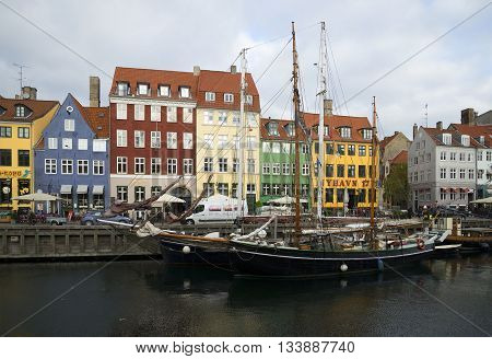 COPENHAGEN, DENMARK - NOVEMBER 03, 2014: Two schooners moored at embankment channel Nyhavn. Tourist landmark of the city Copenhagen