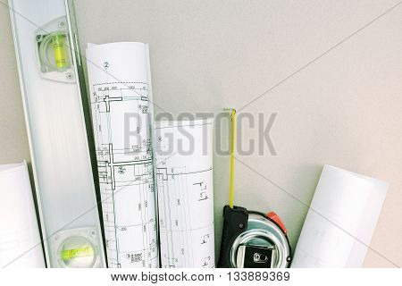 Architectural Blueprint Rolls With Spirit Level And Tape Measure
