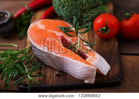 Raw Steak Salmon And Vegetables For Cooking On Wooden Background In A Rustic Style. Dietary Menu. Pr