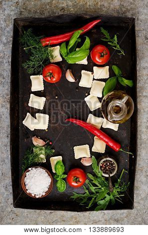 Ravioli With Herbs And Vegetables For Cooking On An Old Dark Background. Top View