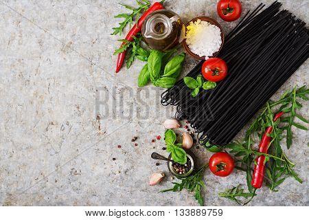Ingredients For Black Linguine Pasta - Tomato, Basil, Chili . Top View