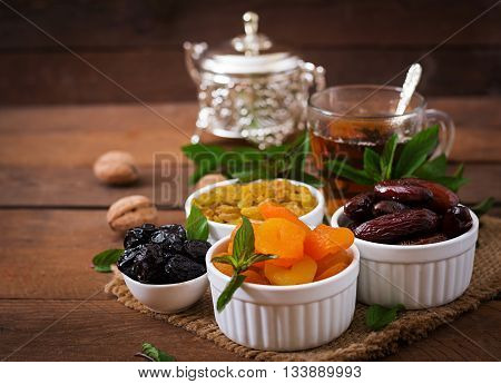 Mix Dried Fruits (date Palm Fruits, Prunes, Dried Apricots, Raisins) And Nuts, And Traditional Arabi