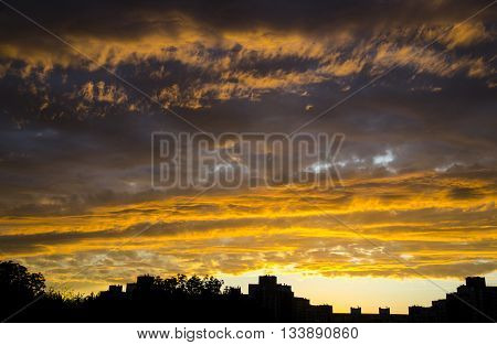 Sky with clouds like fire - amazing sunset. Stormy sky natural background