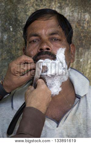 Man At The Barber Shop In Mumbai, India