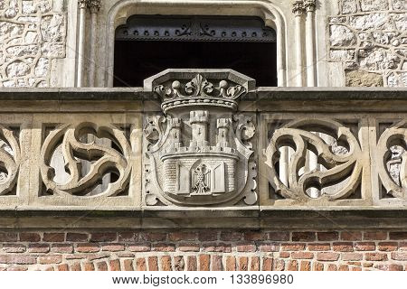 Coat of arms of Cracow- stone carving on Florian Gate in Cracow Poland.
