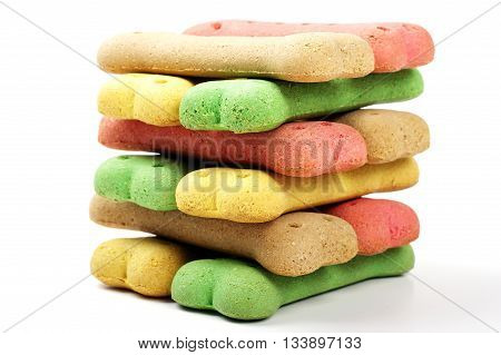 stacked colored dog biscuits in a neat pile