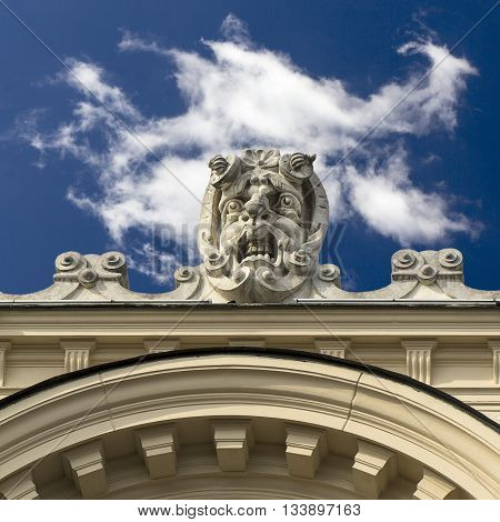 stone gargoyle on building of Juliusz Slowacki Theater Cracow Poland