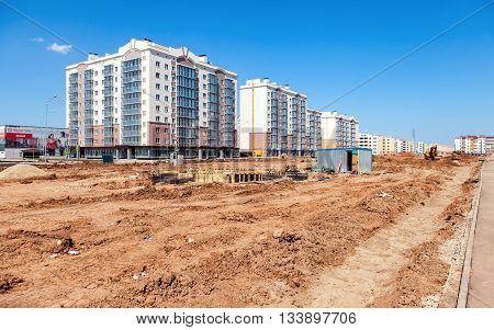 SAMARA RUSSIA - MAY 29 2016: New tall apartment buildings under construction at the Residential District South City in summer sunny day