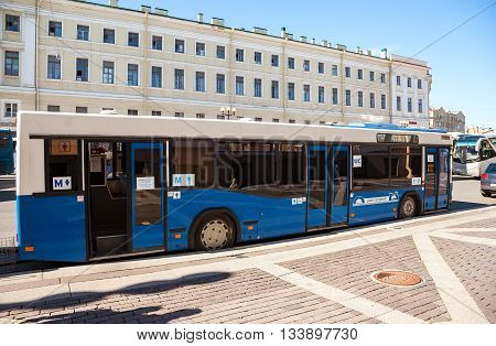 ST. PETERSBURG RUSSIA - AUGUST 7 2015: City bus as a mobile public toilet parked at the city street in summer day