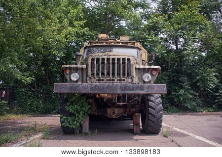 Disguised military truck of the Ukrainian army. Old car on a flat tire.