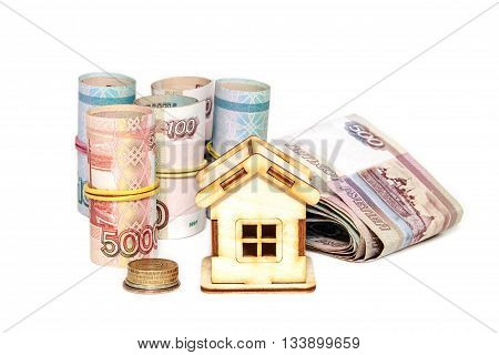 House and money on a white background. Buying a property